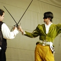 Two opera singers fencing
